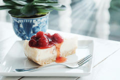 Delicious with dessert a piece of cherry cheesecake on white tone wooden table Royalty Free Stock Photos