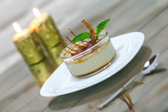 Delicious dessert on the plate with mint leaf Stock Image