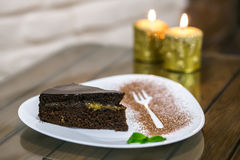 Delicious dessert on the plate with mint leaf Royalty Free Stock Photos