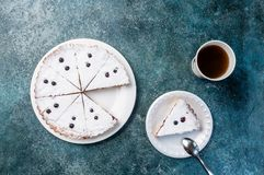 Delicious dessert on a plate with tea. Sweet tasty cheesecake with fresh berries. Top view Stock Images