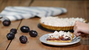 Delicious dessert plum pie, sweet delicious holiday cake with plums and meringue.  stock video footage