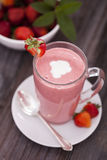 Delicious dessert protein with strawberries. Yogurt in a glass Stock Image