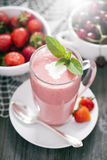 Delicious dessert protein with strawberries. Yogurt in a glass Royalty Free Stock Photography