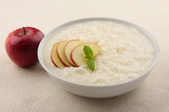 Delicious dessert, rice pudding with apples.. Royalty Free Stock Photos
