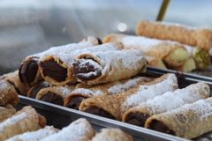 Delicious dessert, traditional sicilian cannoli, chocolate flavor, the famous italian pastry, in a candy shop window stock photos