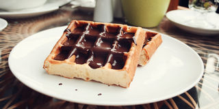 Delicious dessert Vienna Waffles Chocolate topping stock images