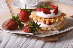 Delicious dessert: waffles with fresh strawberries and cream Royalty Free Stock Images