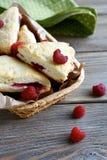 Delicious dessert in wicker basket Stock Images