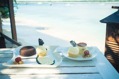 Delicious desserts at beach table Royalty Free Stock Image