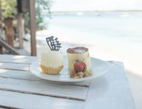 Delicious desserts at beach table Royalty Free Stock Photo