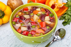 Delicious diet vegetarian soup on the table. Against the background Royalty Free Stock Photo