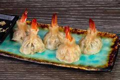 Delicious dim sum with shrimps. And sauce stock photography