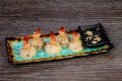 Delicious dim sum with shrimps. And sauce royalty free stock photos