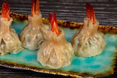 Delicious dim sum with shrimps. And sauce stock photos