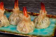 Delicious dim sum with shrimps. And sauce stock image