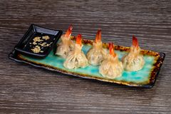 Delicious dim sum with shrimps. And sauce stock images