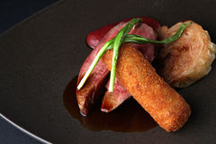 Delicious dinner. Duck breast of a kromesk from a duck leg plum Stock Photo