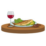 Delicious dinner with a glass of wine. Deliciously cooked fish and a glass of red wine Stock Image