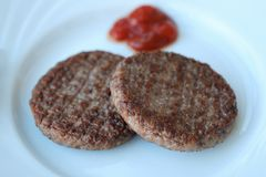 Delicious dinner meat patties with ketchup view Royalty Free Stock Photo