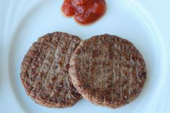 Delicious dinner meat patties with ketchup view Royalty Free Stock Images