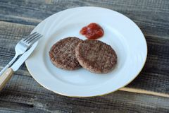 Delicious dinner meat patties with ketchup view Stock Photography