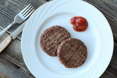 Delicious dinner meat patties with ketchup view Stock Image