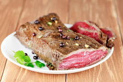 Delicious dinner of rare roast beef Stock Photos
