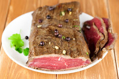 Delicious dinner of rare roast beef Stock Photography