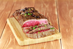 Delicious dinner of rare roast beef Royalty Free Stock Images