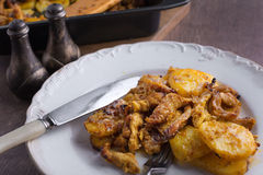 Delicious dinner roasted potatoes with chicken Royalty Free Stock Photo