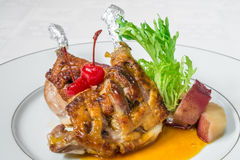A delicious dish. Chicken ham fried on a grill, sauce and herbs. Horizontal frame Stock Photography