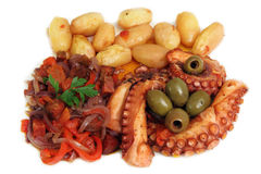 A delicious dish of grilled octopus. Delicious grilled octopus with olives, potatoes and capsicum Royalty Free Stock Photography