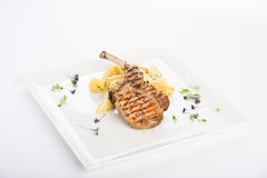 Delicious dish. Potatoes with grilled lamb, amazing dish Royalty Free Stock Image