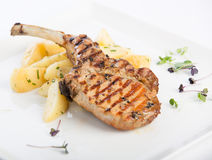 Delicious dish. Potatoes with grilled lamb, amazing dish Stock Images