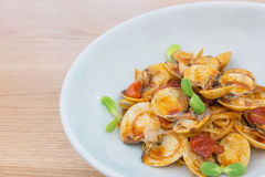 Delicious dish of spicy pasta with shellfish and Sunflower sprou Royalty Free Stock Images