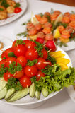 Delicious dishes. Some appetizing food at banquet table stock photography