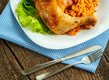 Delicious dishes from chicken thigh with rice and salad leaves Stock Image