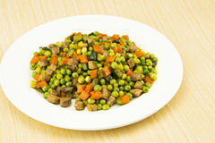 Delicious dishes, peas and pork Stock Photos