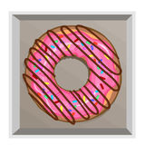 A delicious donut in a pink frosting with sprinkle and chipped chocolate Stock Photography