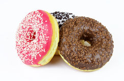 Delicious donuts on a white background Stock Images