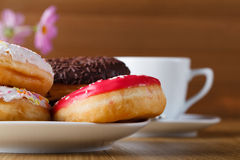 Delicious donuts on wood table in dish Royalty Free Stock Photography