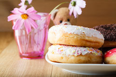 Delicious donuts on wood table with toy Stock Images