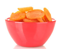 Delicious dried apricots in bright bowl Stock Photo
