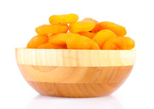 Delicious dried apricots in wooden bowl Stock Photos