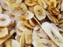 Delicious dried Banana Chips in bulk for background or graphic resource. Delicious dried Banana Chips in bulk - for background or graphic resource stock image