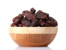 Delicious dried dates in wooden bowl Royalty Free Stock Images