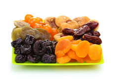 Delicious dried fruits on plate Stock Images