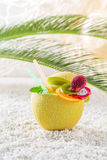 Delicious drinks in fresh fruits on sandy beach Royalty Free Stock Photos
