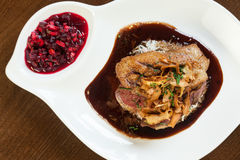 Delicious duck breast dish with gravy and rice Stock Photos