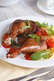 Delicious duck legs with apples closeup vertical Royalty Free Stock Photos